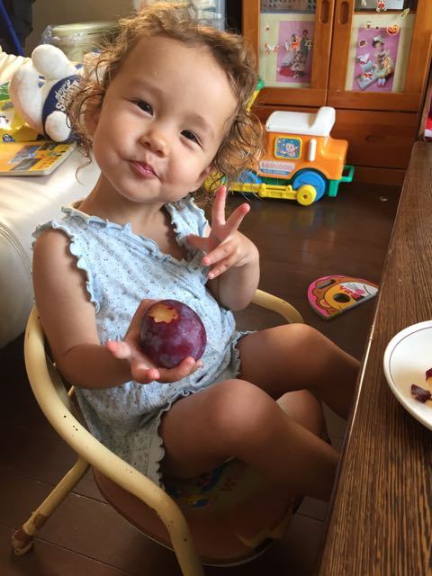 Yurika is eating a plum.
